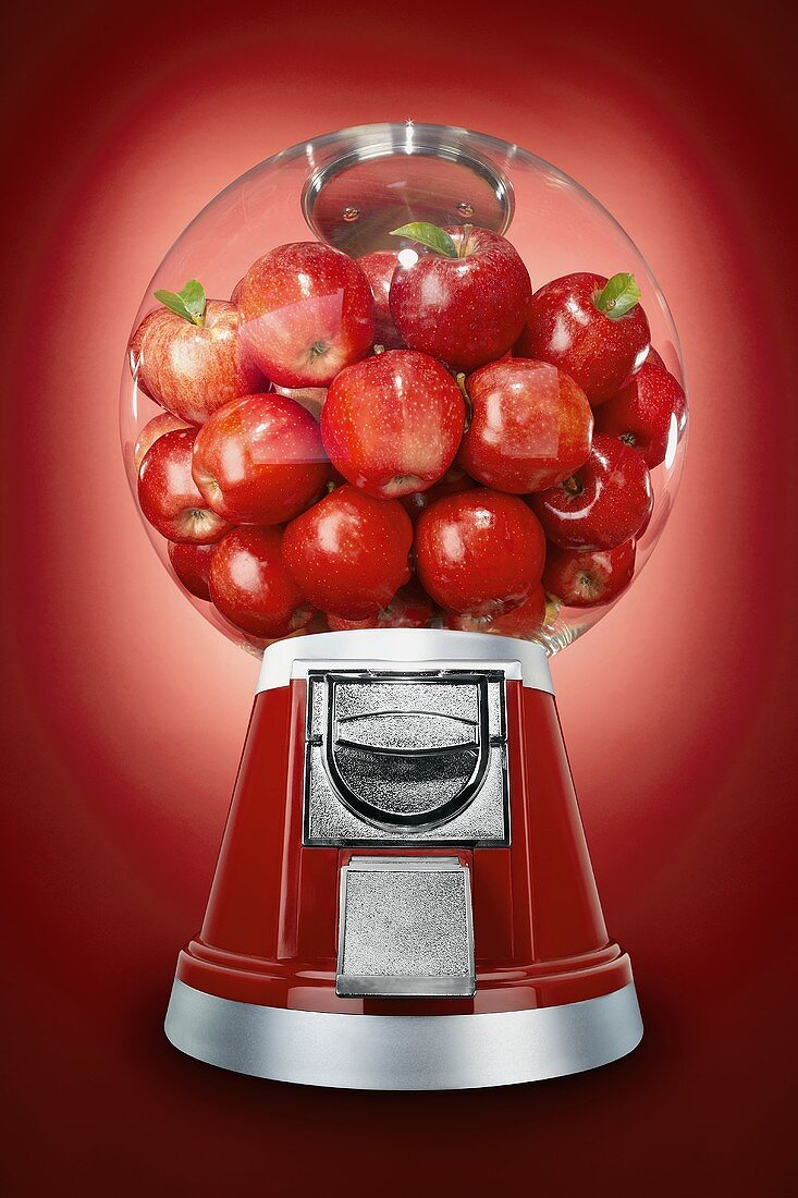 Red Apples in a Candy Dispenser