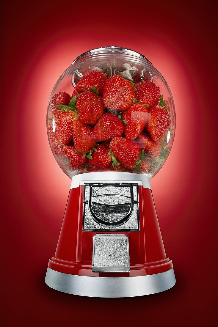 Strawberries in a Candy Dispenser
