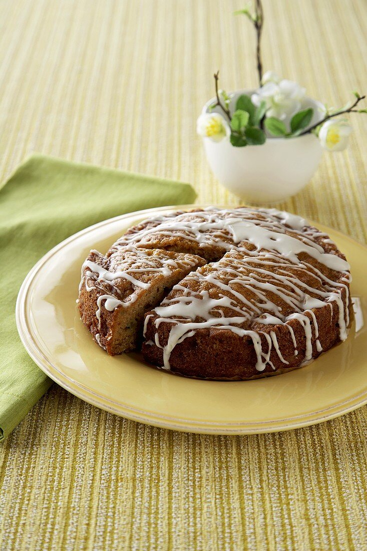 An Apple Cake with Icing, One Slice Removed