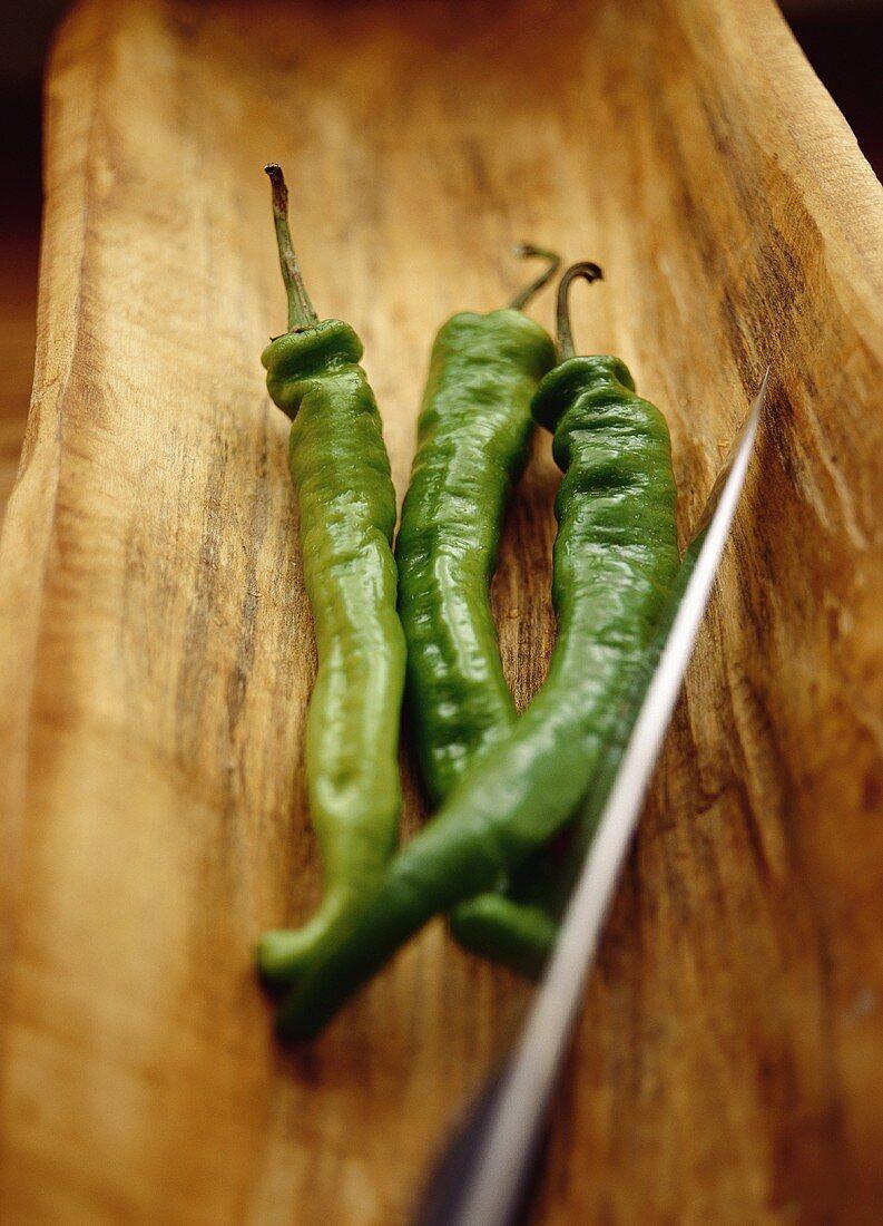 Three green chilis