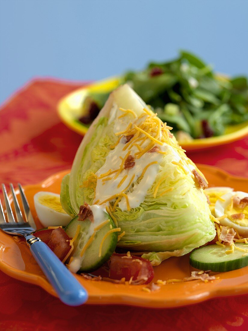 A Wedge of Iceberg Lettuce with Ranch Dressing, Bacon Bits, Cheese and Hard Boiled Egg
