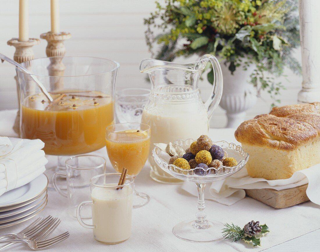 Breakfast buffet with brioche, milk and orange punch