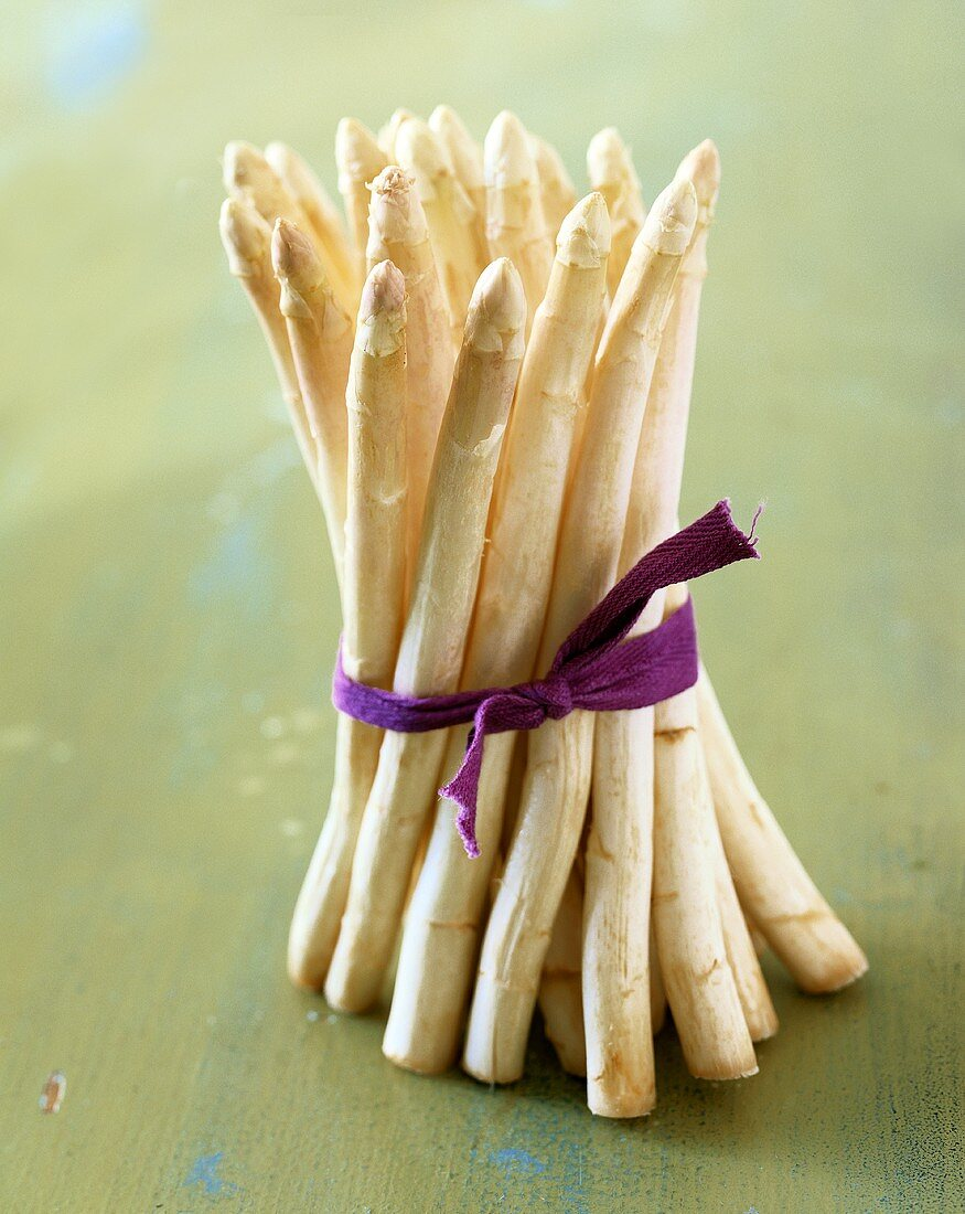 Bundle of White Asparagus Tied with a Purple Cloth Ribbon