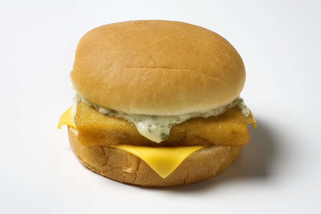 A Fried Fish Sandwich with Tartar Sauce and Cheese