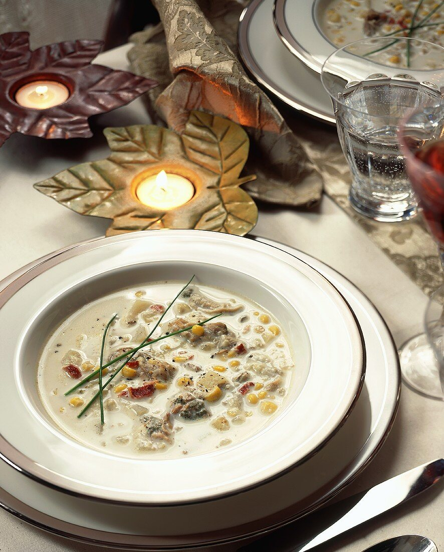 Oyster and sweetcorn soup on table with autumn decorations