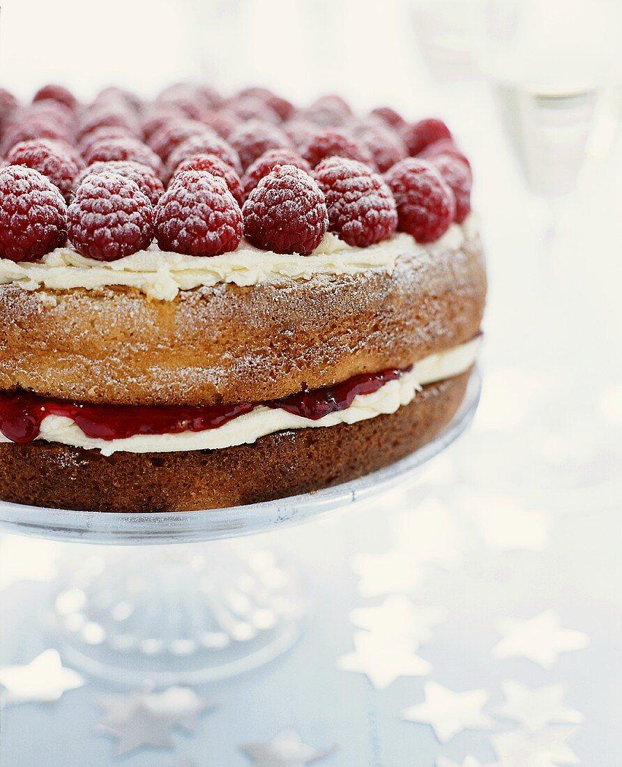 Victoria Sponge Cake Topped with Fresh Raspberries and Powdered Sugar