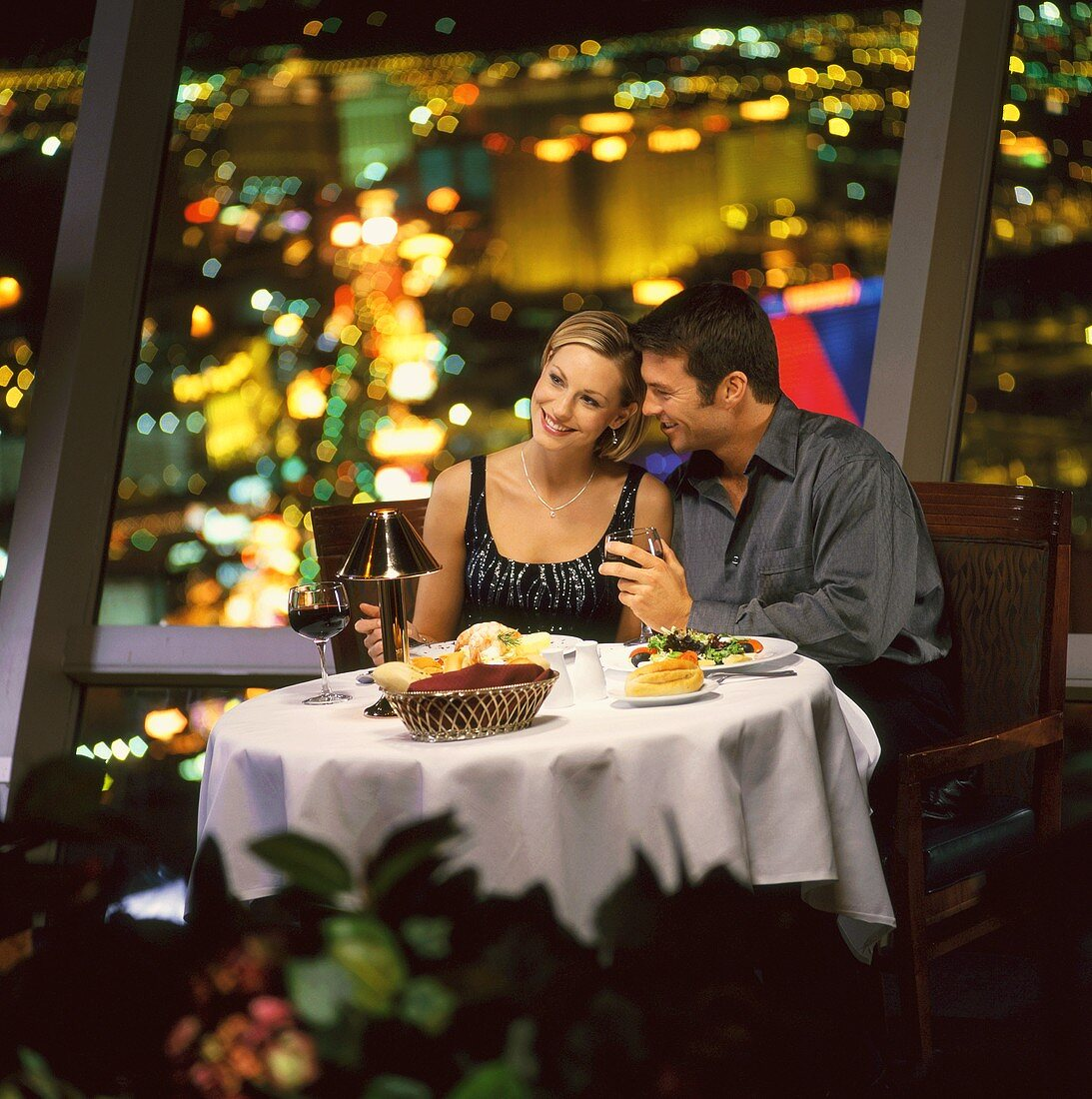 Couple Dining in Restaurant with City Night View