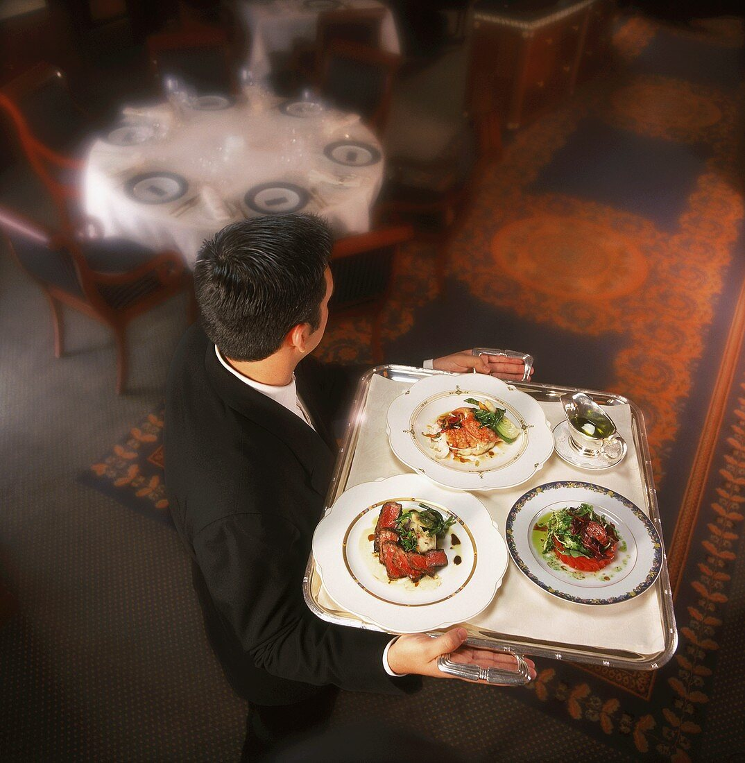 Waiter Carrying Tray with Three Entrees