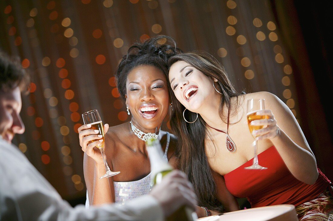 Women in Nightclub with Drinks