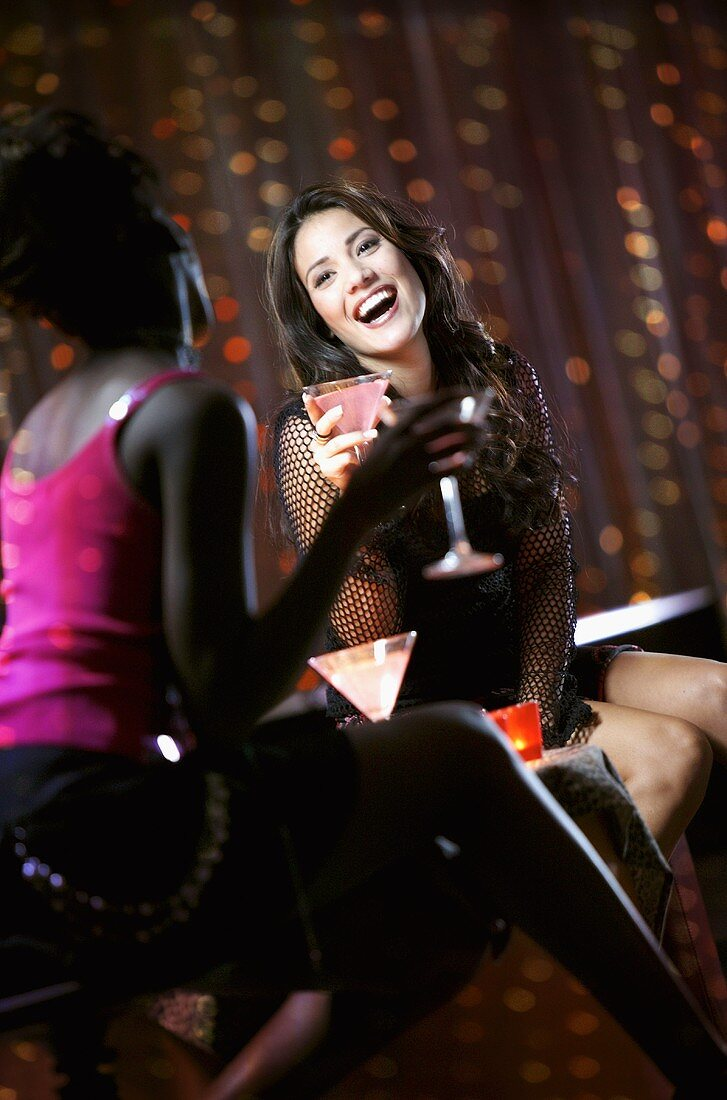 Woman in Nightclub Holding Cocktail