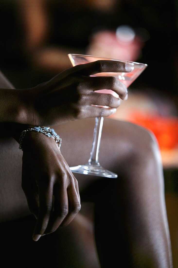 Close-up of Woman in Nightclub with Martini Glass