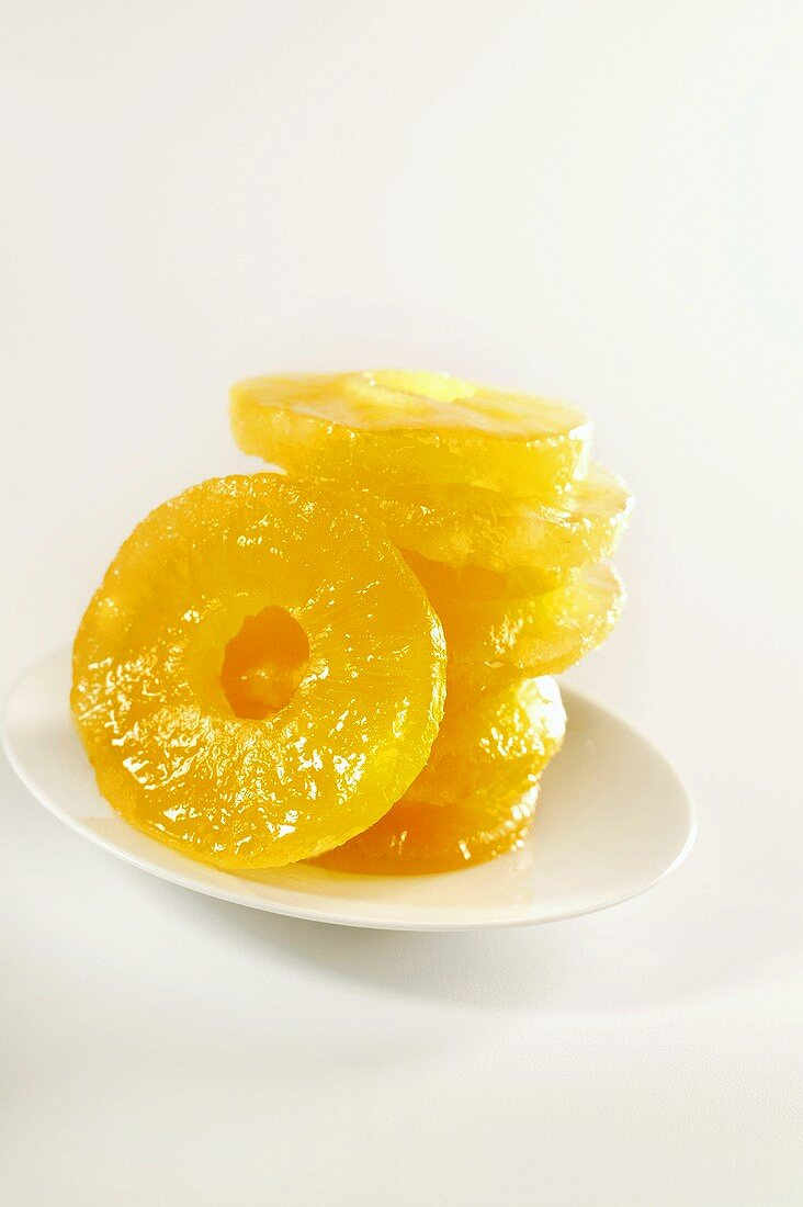 Plate with Stack of Candied Pineapple Rings on White