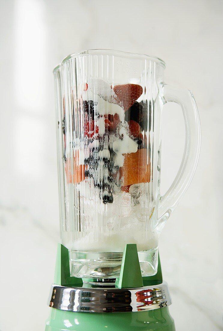 Fruit, yoghurt and ice cubes in liquidiser