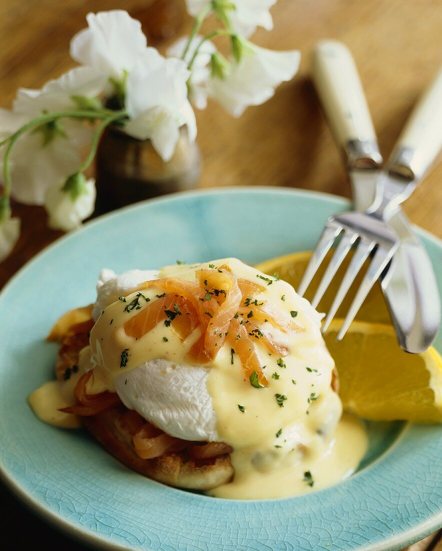 Poached Egg on an English Muffin with Salmon and Hollandaise Sauce; Fork and Knife