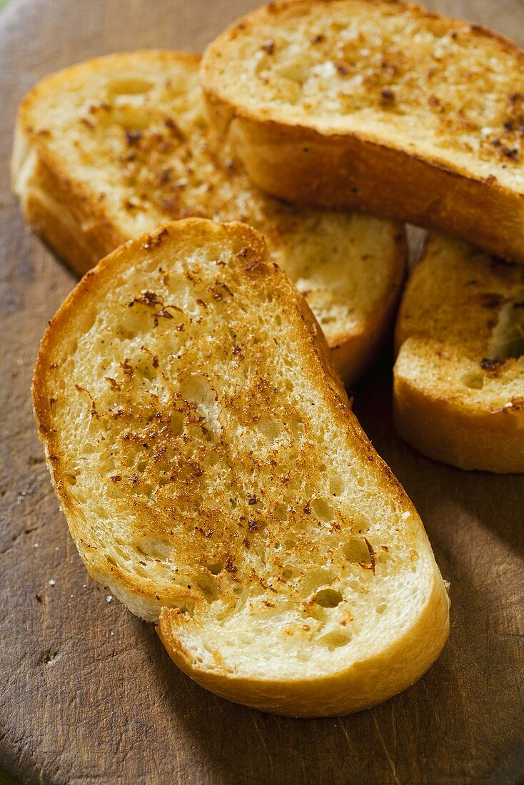 Garlic Bread on Rustic Wooden Cutting Board