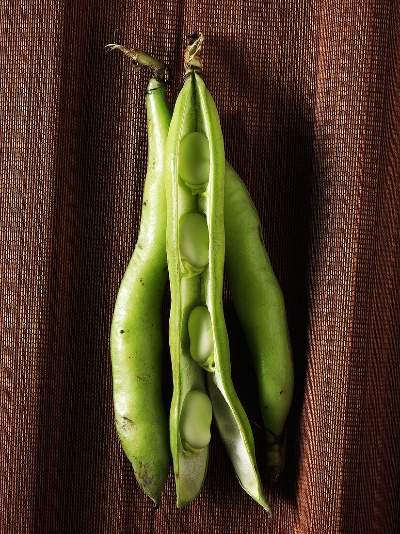 Three Whole Lima Beans; One Sliced Open