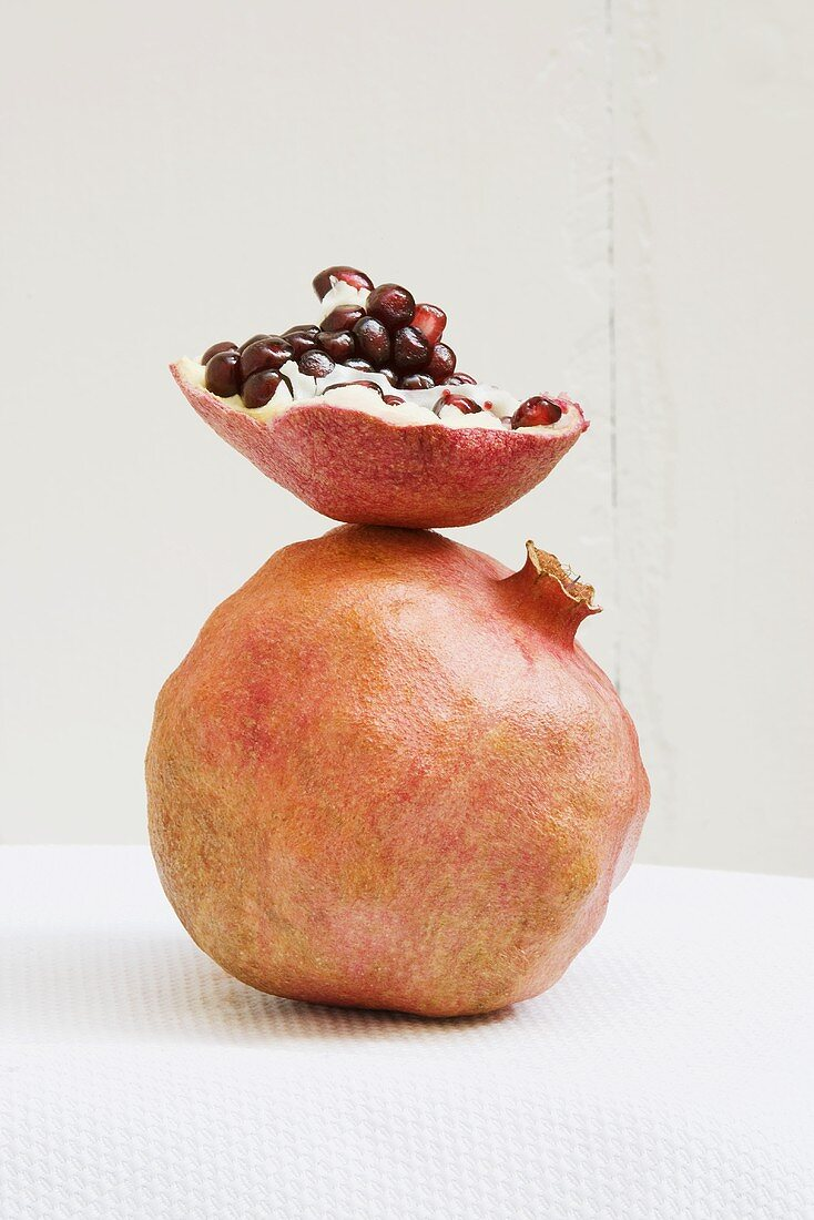 Whole Pomegranate with a Piece of Pomegranate