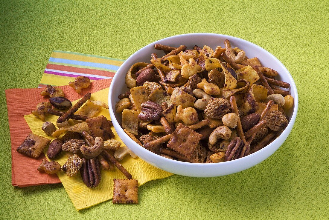 Spicy Snack Mix in a Bowl; Beside Bowl on Napkins
