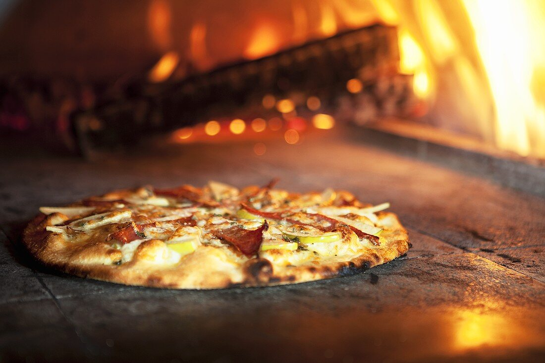 Pizza with Green Apples, Prosciutto, Cheddar Cheese and Onions; Brick Oven
