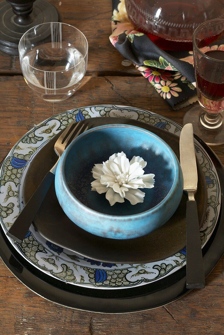 Place Setting with White Flower in Bowl