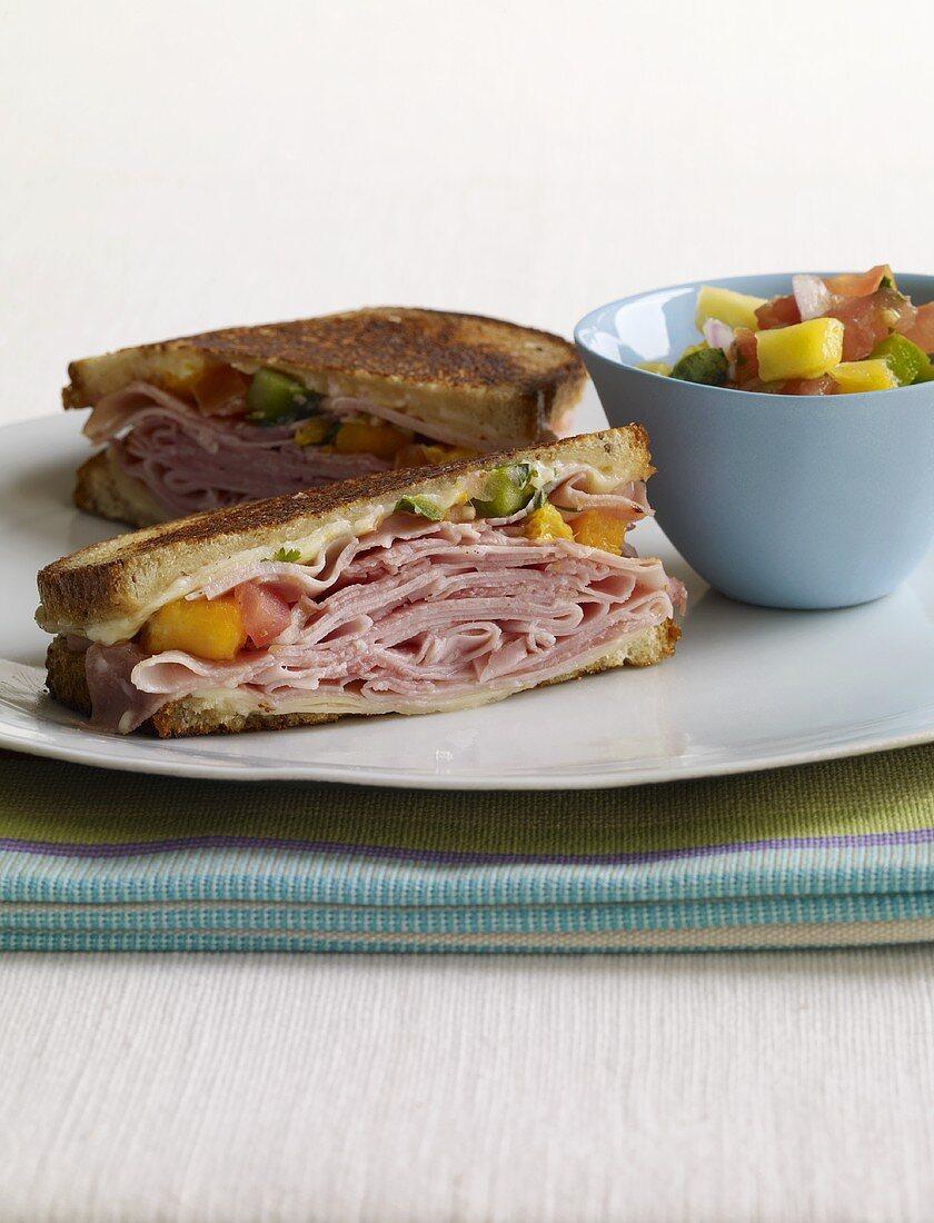 Halved Ham Sandwich with Mango Salsa