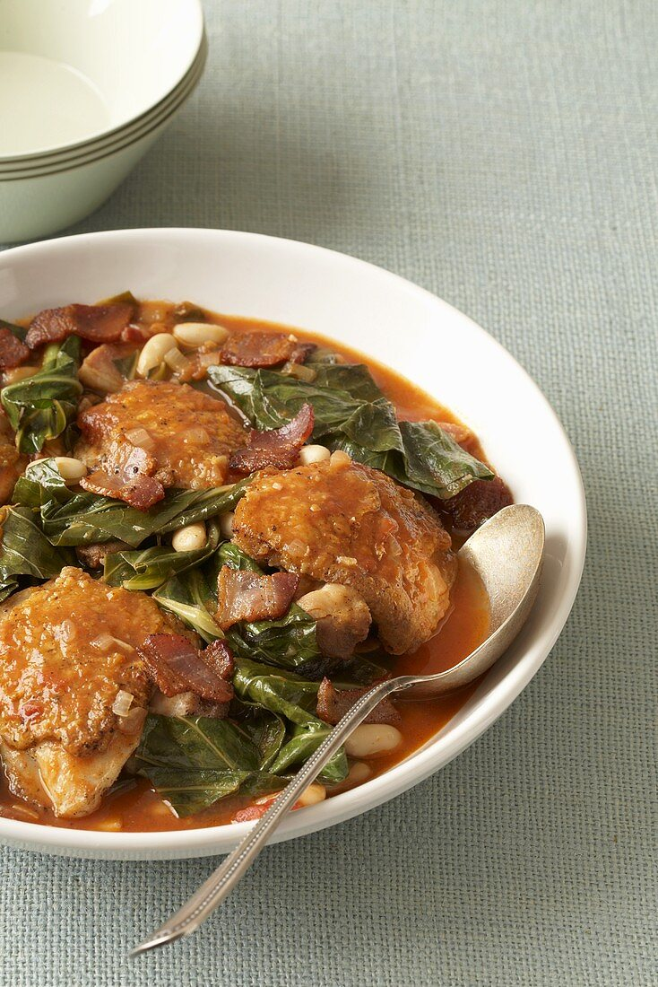 Chicken and Collard Green Stew in Serving Bowl with Spoon