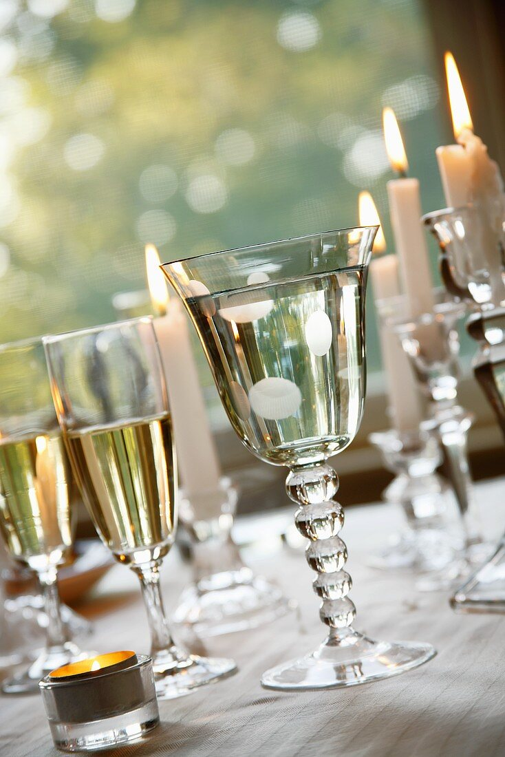 Outdoor Table with Glasses of White Wine and Water; Candles