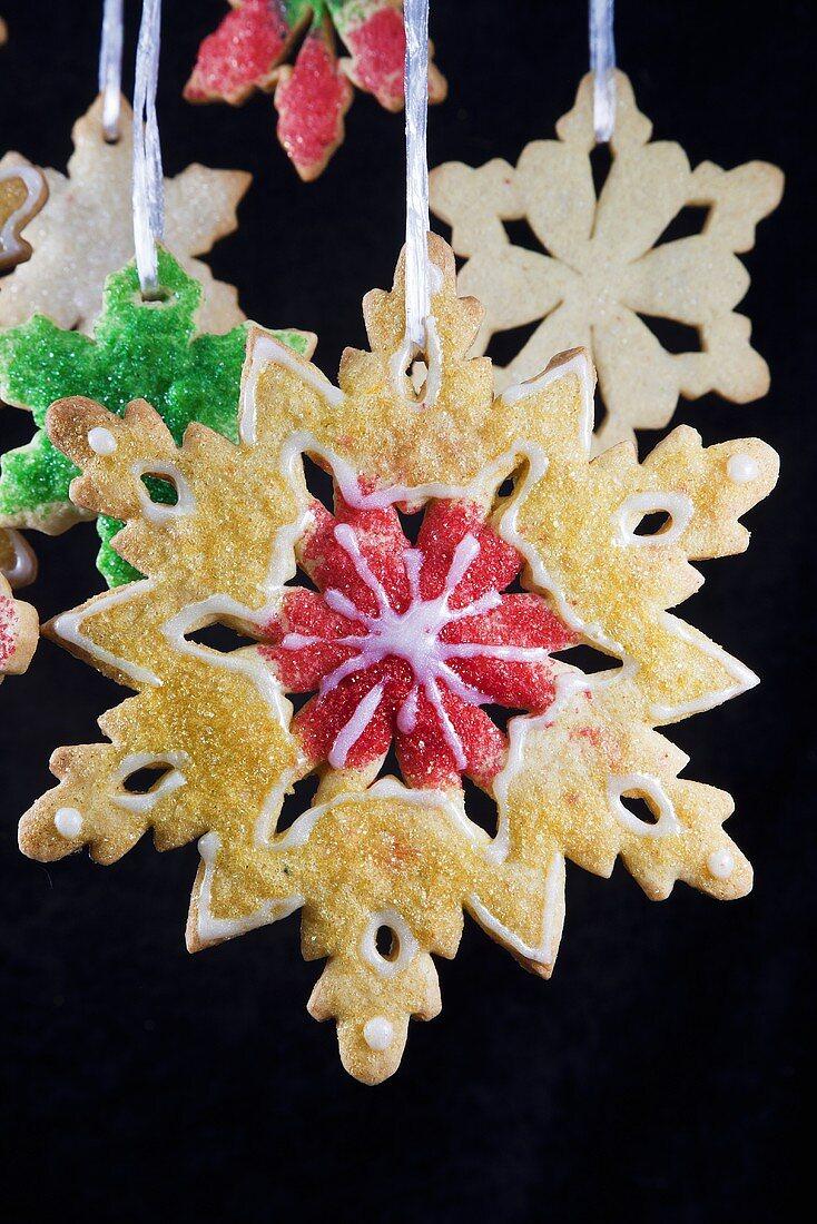 Christmas Snowflake Sugar Cookies Hanging; Black Background