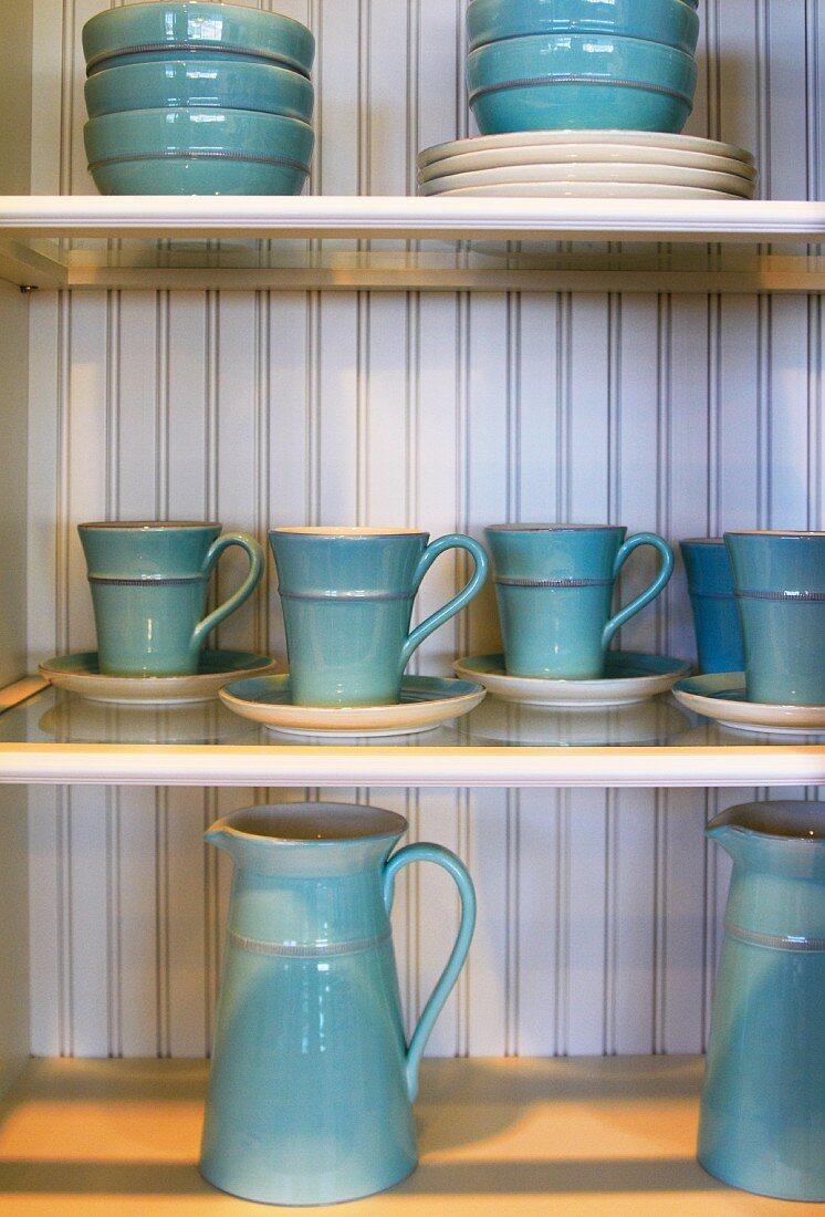 Kitchen Shelves with Blue Ceramic Dishware