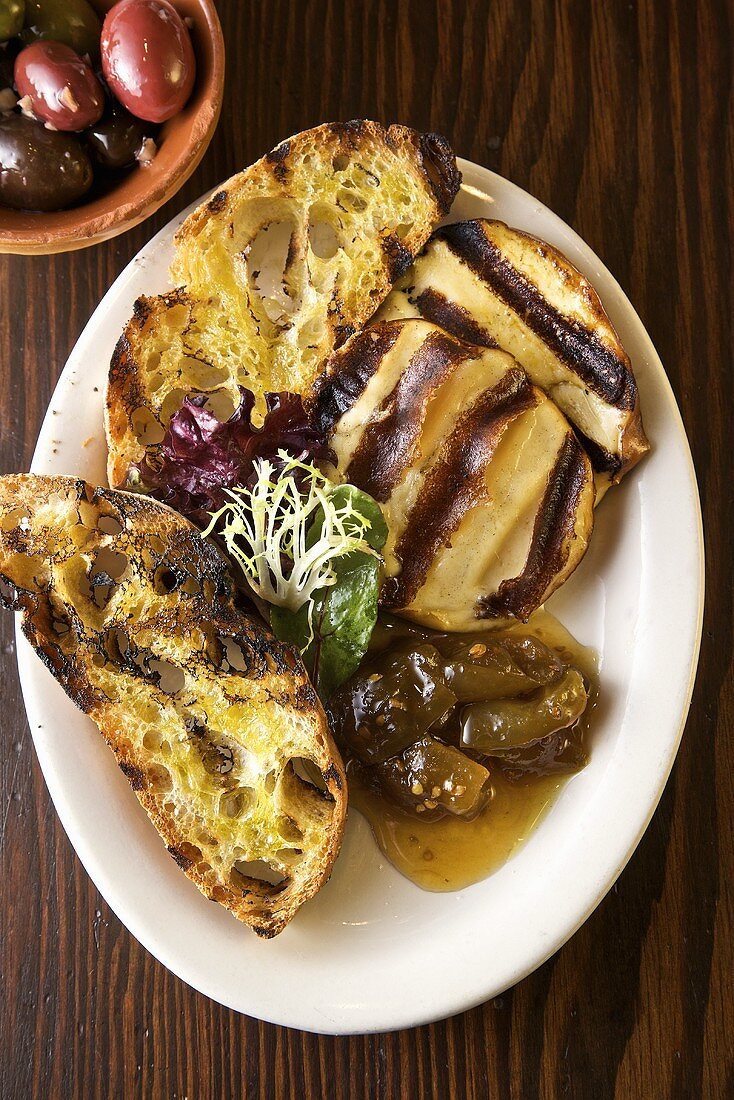 Grilled Scamorza Cheese with Rustic Bread, Green Tomato Preserve and Olives