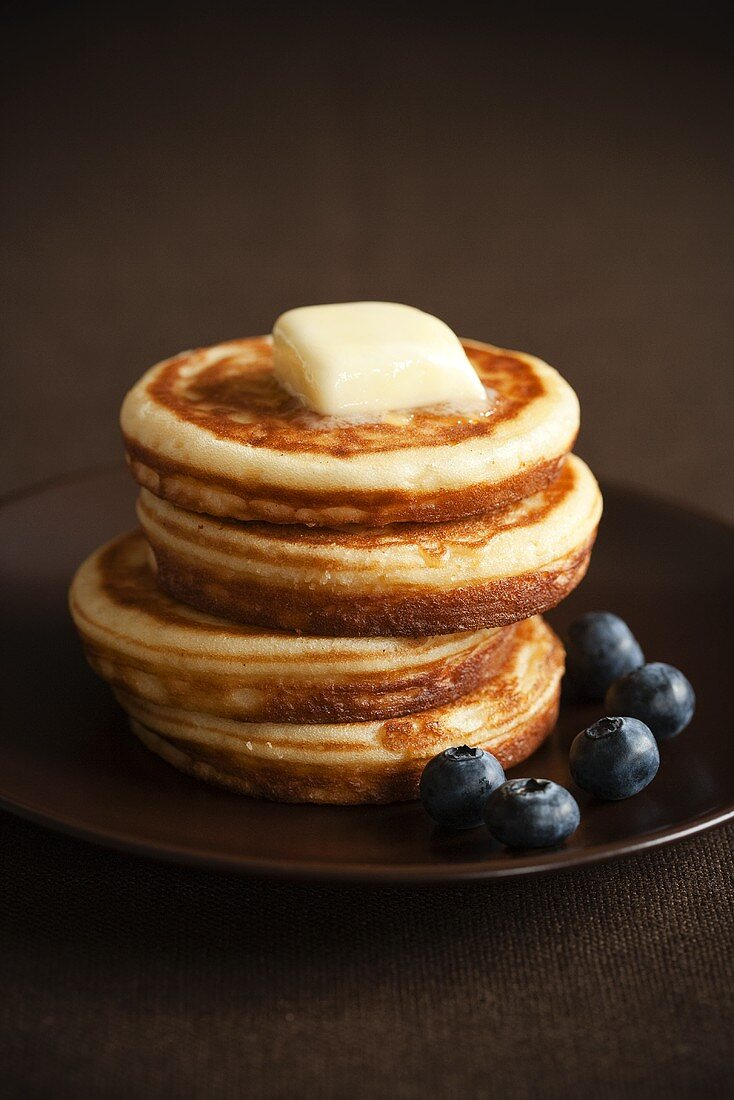 Stack of Four Pancakes with Butter and Blueberries