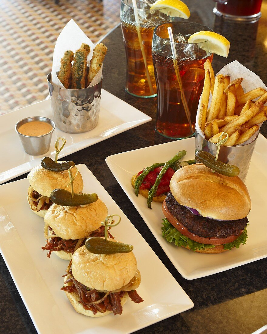 Diner Food; Barbecue Pork Sliders, Hamburger, French Fries, Fried Zucchini Strips and Iced Tea