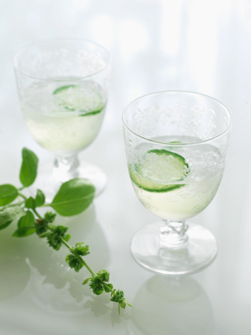 Two Glasses of Culinary Cocktail with Cucumber