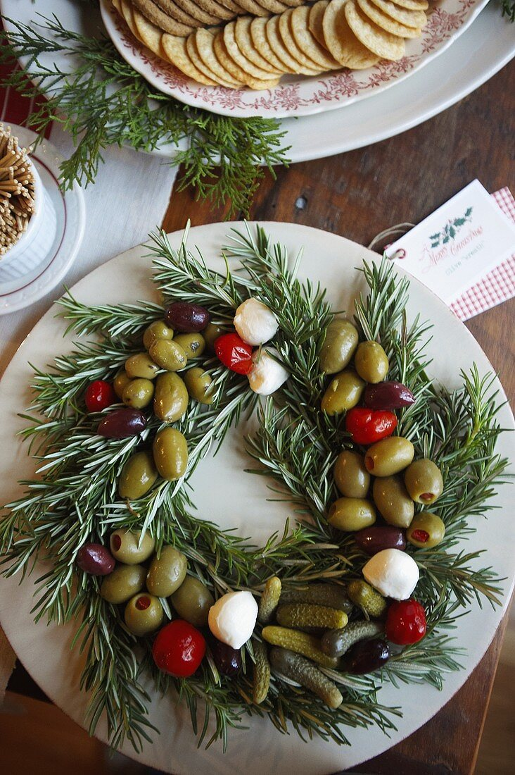 Olive Wreath Made on Rosemary with Mozzarella and Tomatoes; Crackers; From Above