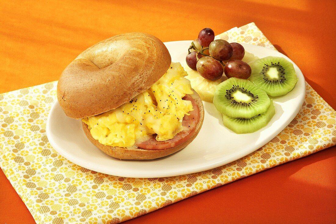 Breakfast Sandwich; Eggs and Canadian Bacon on a Bagel; Fresh Fruit