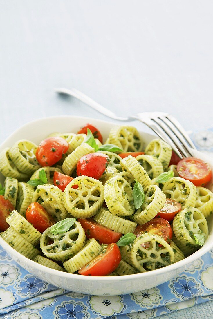 Pesto Wagon Wheels with Cherry Tomatoes in a Bowl with a Fork
