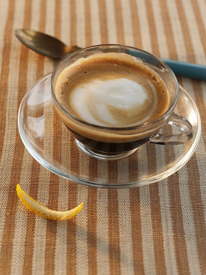 Macchiatto with Foam in a Glass Cup with Saucer