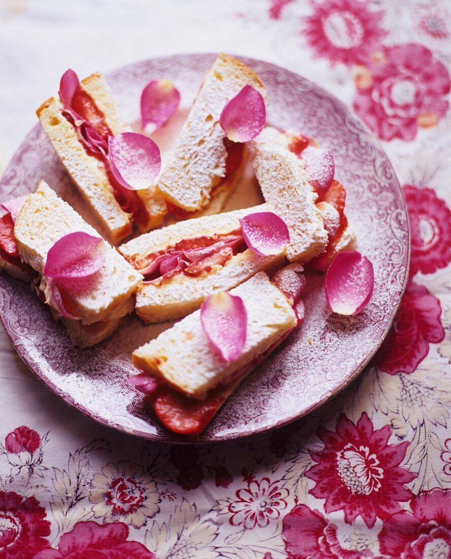 Cake and Strawberry Tea Sandwiches Decorated with Rose Petals