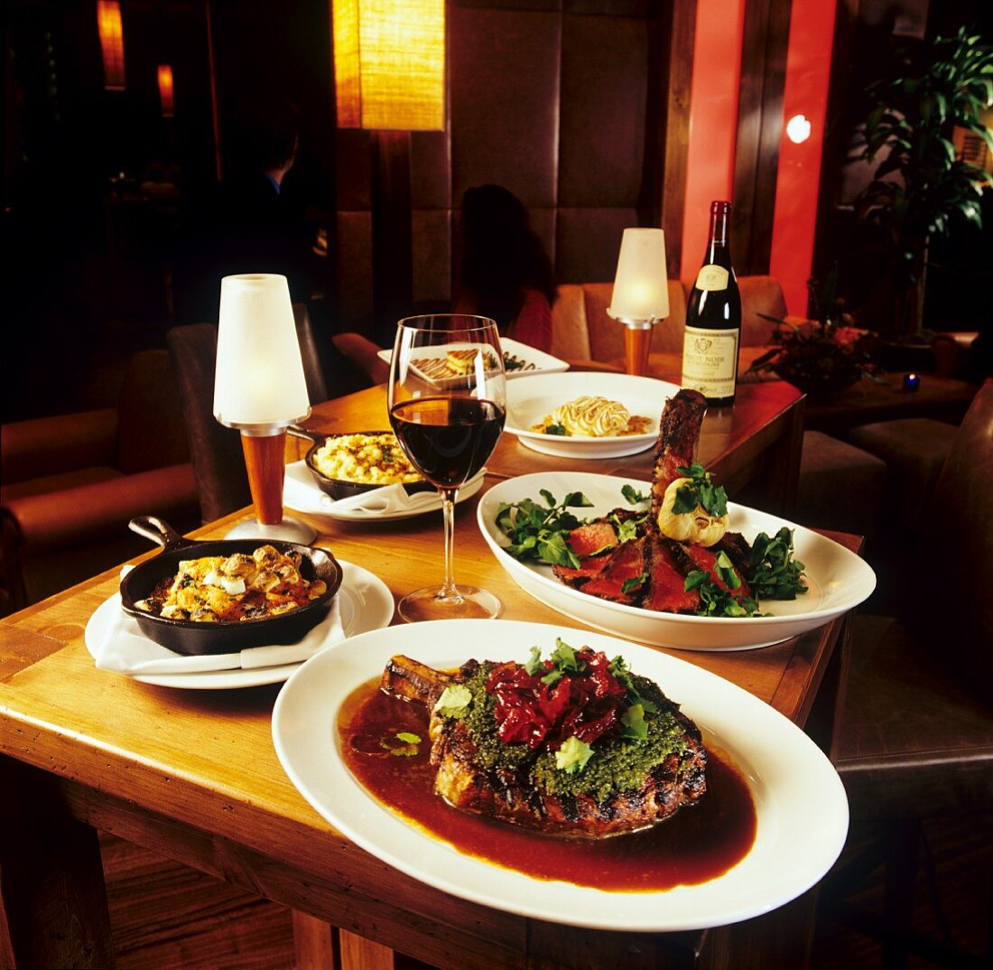 Assorted Entrees on a Table with Red Wine