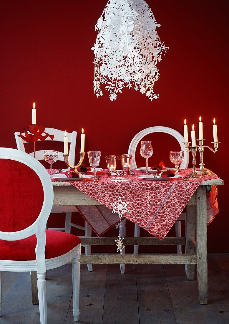 A table laid fro Christmas dinner with designer lamps