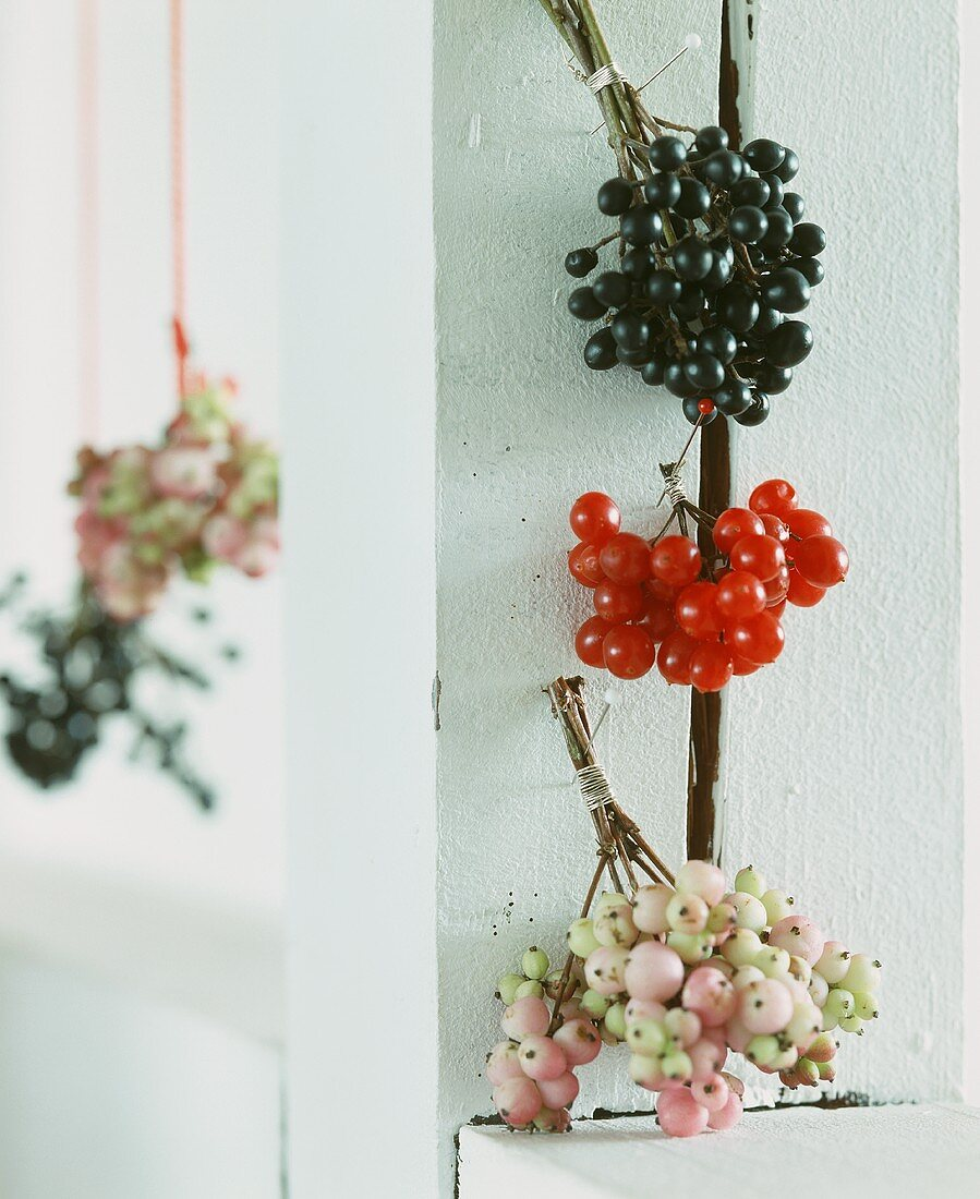 Small bouquets of berries as wall decoration