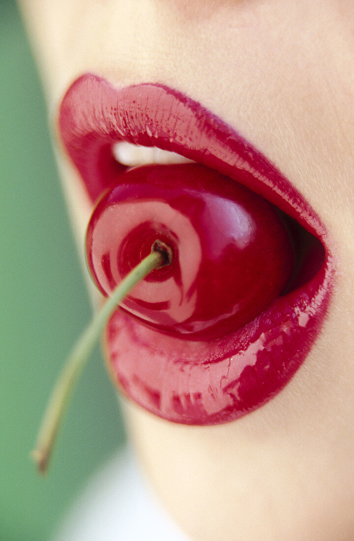 Adult, Adults, Bite, Bites, Biting, Cherries, Cherry, Close up, Close-up, Closeup, Color, Colour, Concept, Concepts, Contemporary, Detail, Details, Eat, Eating, Female, Food, Fruit, Fruits, Girl, Girls, Human, Lip gloss, Lip-gloss, Lips, Mouth, Mouths, No