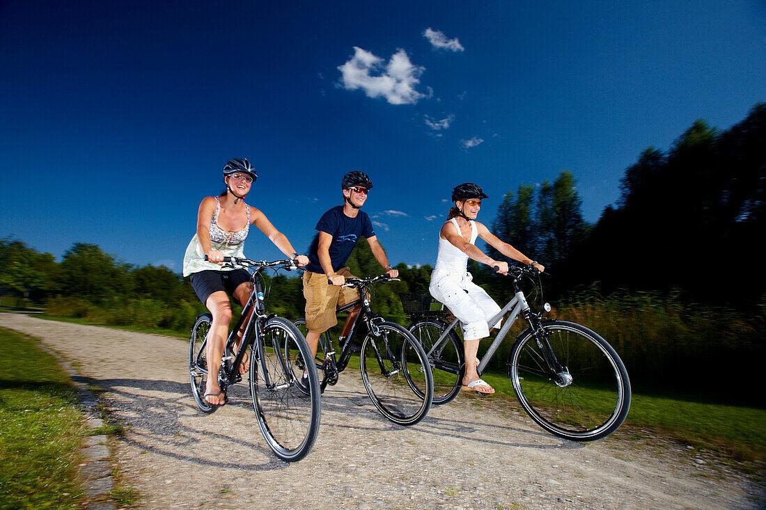 Three cyclists, Bavaria, Germany