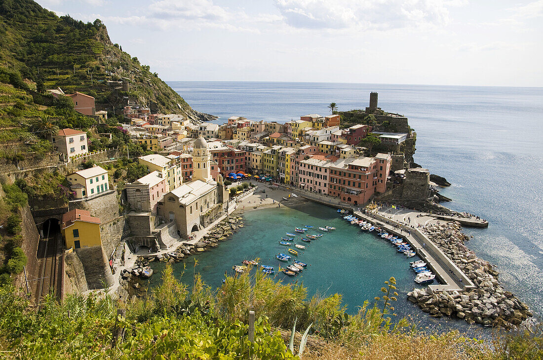 Italy,  Cinque Terre,  Vernazza.  Small town on the Italian Riviera.  One of the five villages on the famous Cinque Terre hiking trail.  Viewed from the trail on the cliffs above.
