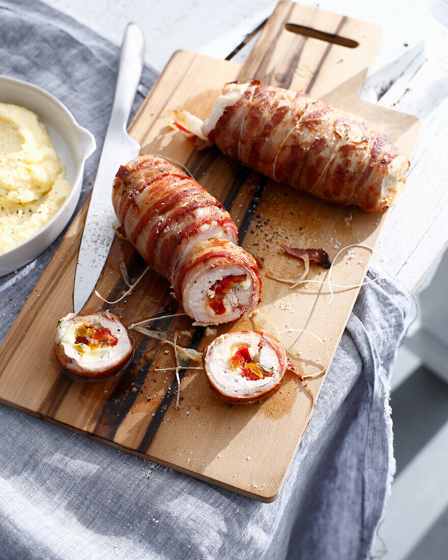 Chicken involtini on wooden board. ChickenInvoltiniA