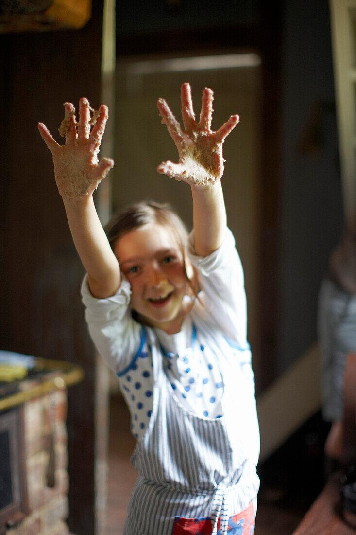 Girl showing sticky hands, Klein Thurow, Roggendorf, Mecklenburg-Western Pomerania, Germany