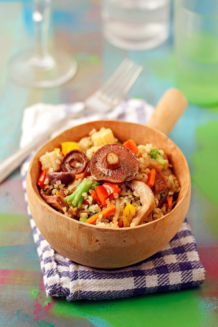 Bulgur wheat with mushrooms and vegetables