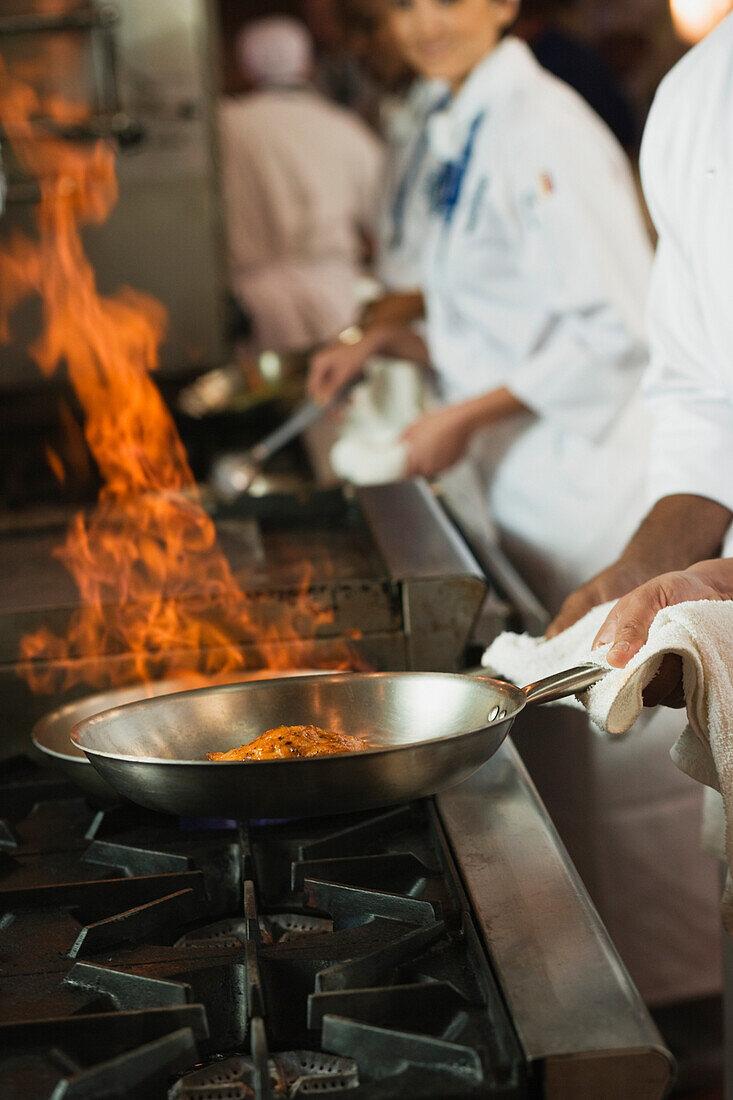 Food flaming in pan, Orlando, FL