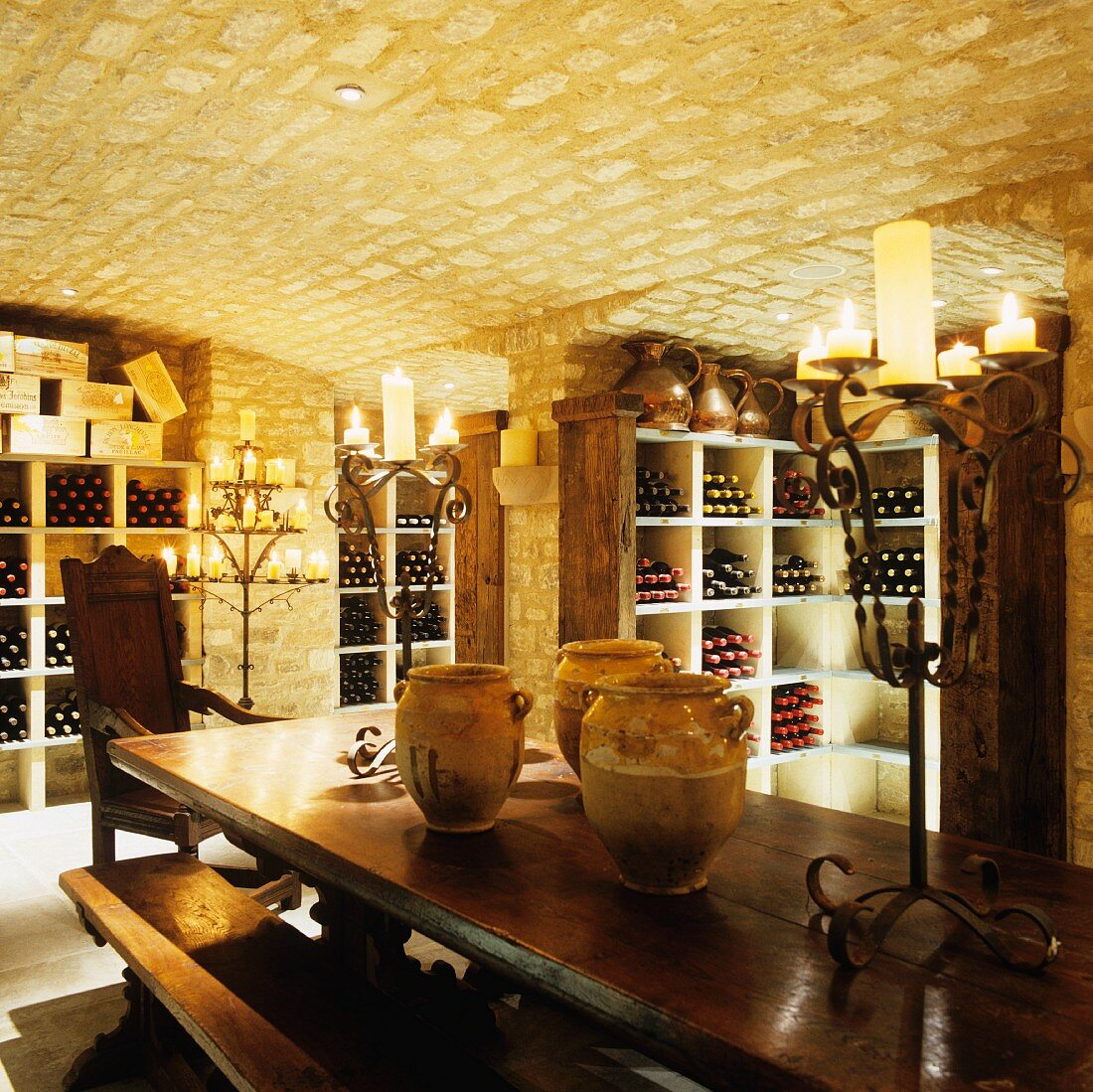 An old wine cellar with a vaulted ceiling lit by candle light
