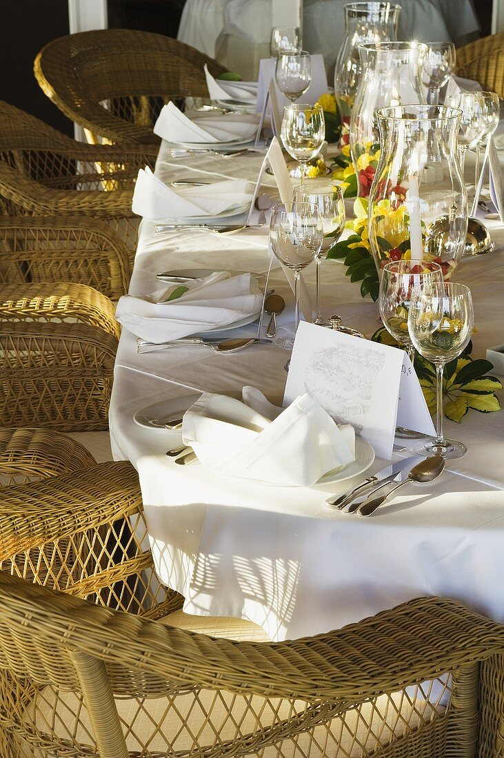 Wicker chairs around a festively laid table